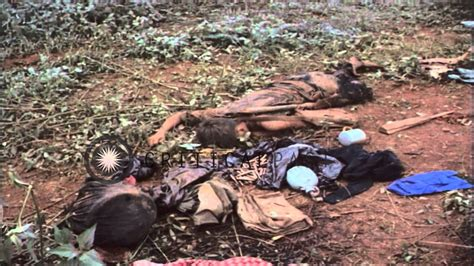 Dead men and children lying on the ground after the Viet